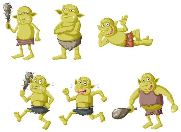 Set van groene goblin of trol in verschillende poses in stripfiguur geïsoleerd Gratis Vector
