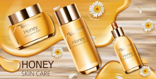 Set van honingcosmetica met crème, gezichtsessentie en spuitfles Gratis Vector