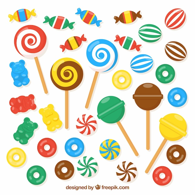 Set van kleurrijke snoepjes in vlakke stijl Gratis Vector