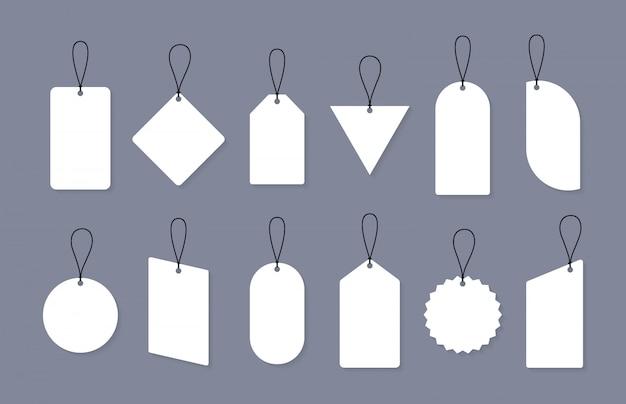 Set van lege verkoop of prijskaartjes in verschillende vormen. set blanco etiketten voor korting, verkoop, prijskaartjes. Premium Vector