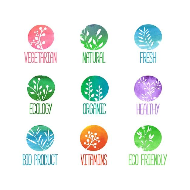 Set van logo's, pictogrammen, labels, stickers of stempels. silhouetten van twijgen, bladeren, planten, bessen. gekleurde aquarel textuur. Premium Vector
