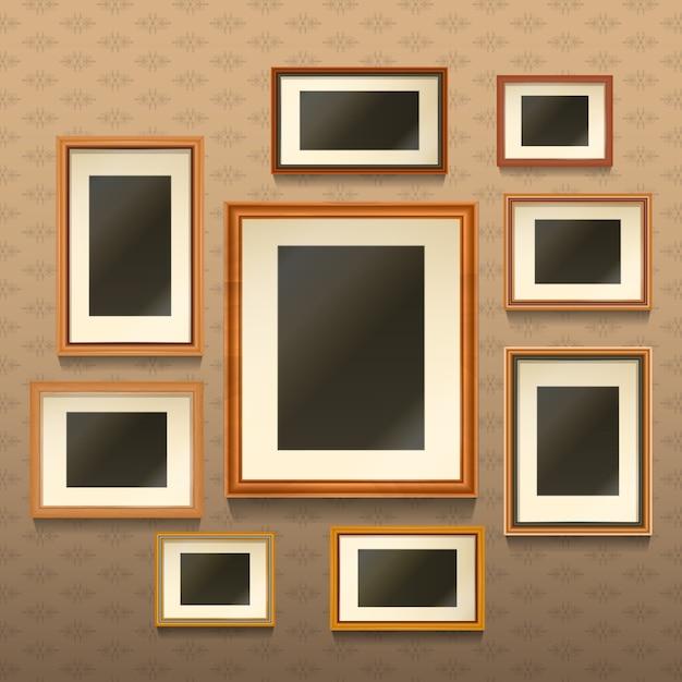 Set van realistische lege afbeeldingsframes op de muur Gratis Vector