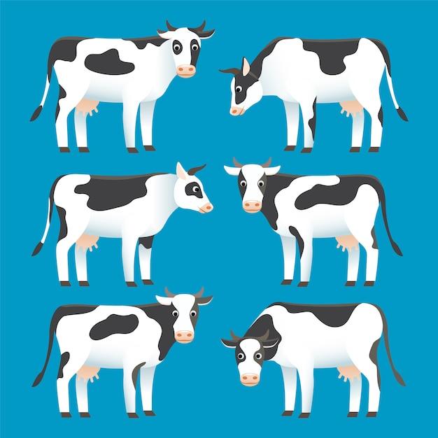 Set van schattige zwart-wit gevlekte koeien geïsoleerd op blauwe achtergrond Premium Vector