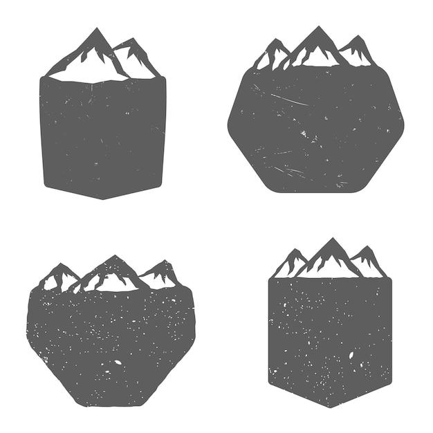 Set van schilden met bergen, in vintage zwart-wit stijl. vector illustratie Premium Vector