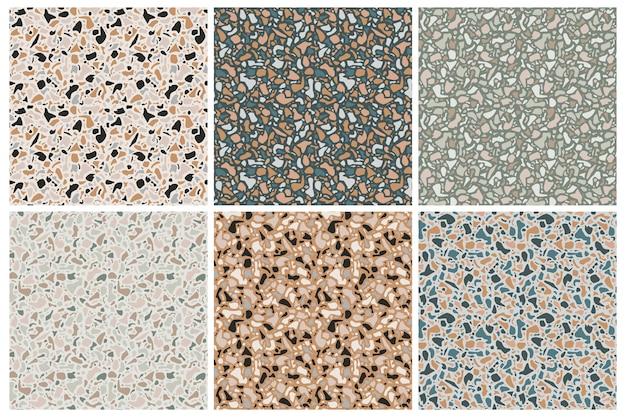 Set van terrazzo achtergrondpatronen. naadloze patronen. natuursteen, glas, kwarts, beton, marmer. klassiek italiaans type vloer. terrazzo designelementen. Premium Vector