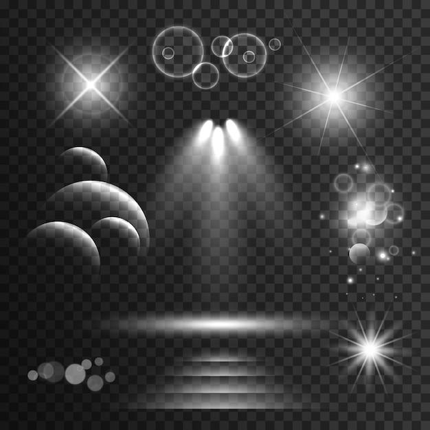 Set van transparante lichteffecten en schittert met lens flares achtergrond Gratis Vector