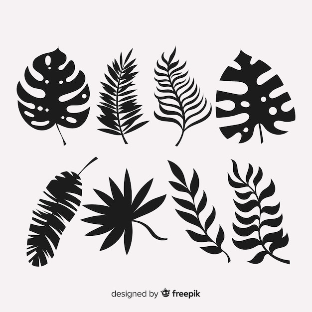 Set van tropische bladeren met silhouet stijl Gratis Vector