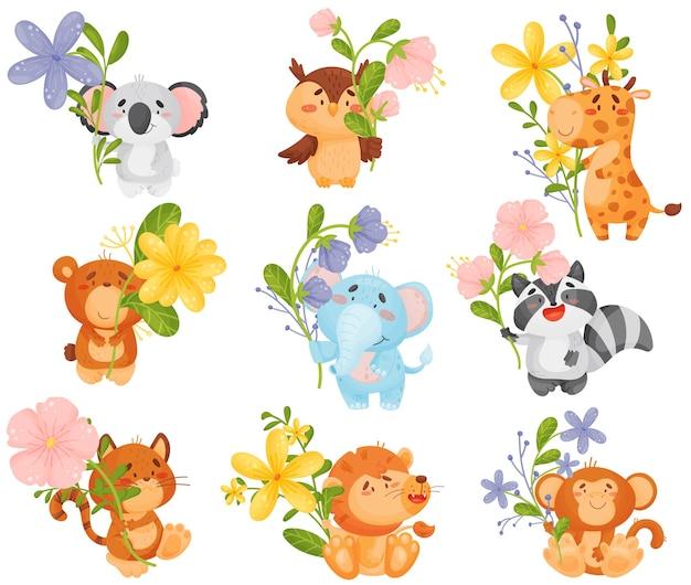 Set van verschillende tekenfilm dieren met bloemen Premium Vector