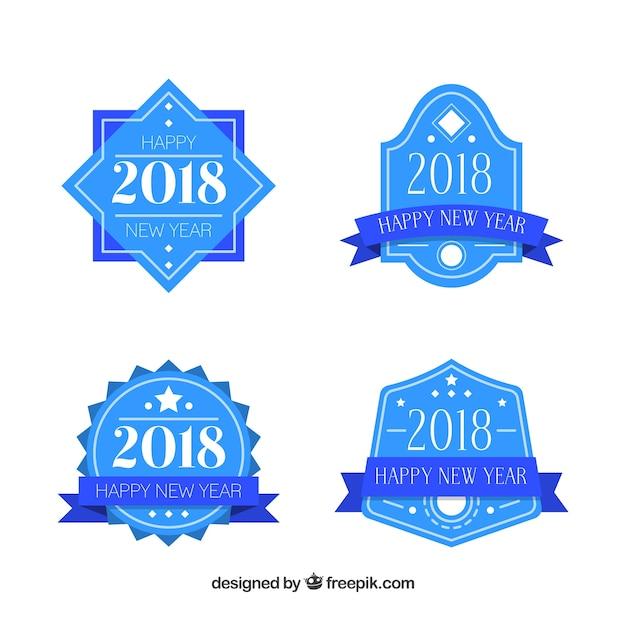 Set van vier blauwe nieuwjaars badges Gratis Vector