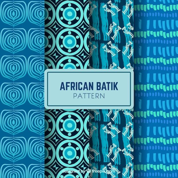 Set van vier met de hand getekende patronen in blauwe tinten Gratis Vector