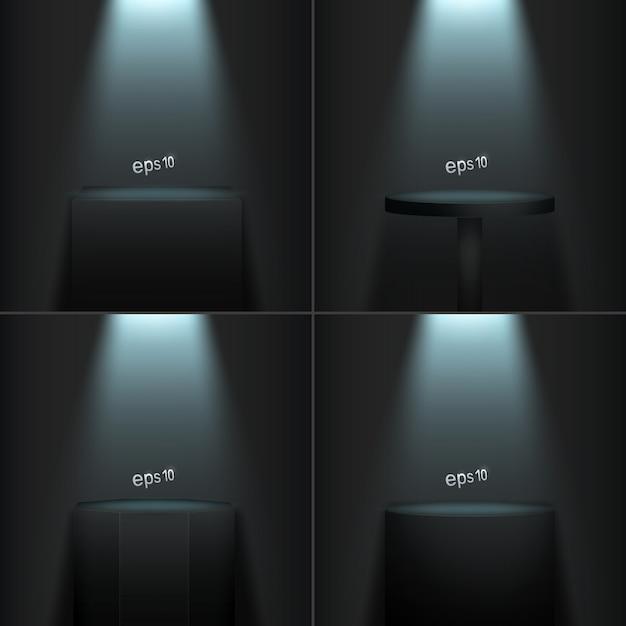 Set van vier realistische podia op een donkere kamer. Premium Vector