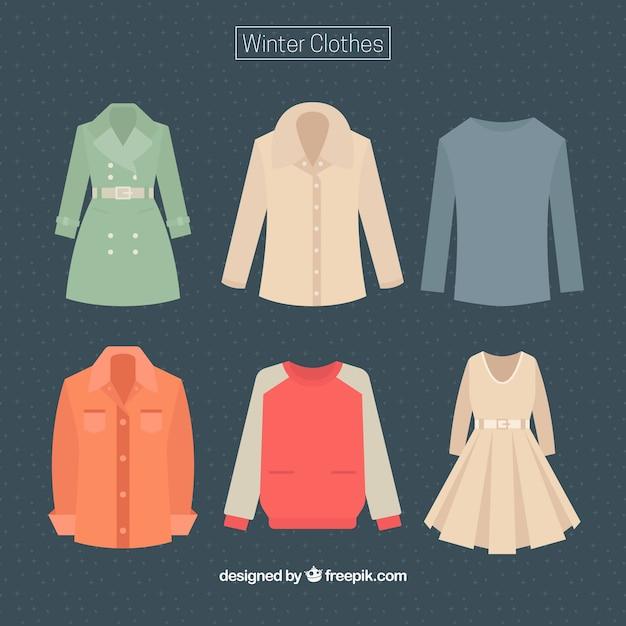 Set van vrouwelijke en mannelijke winterkleren Gratis Vector