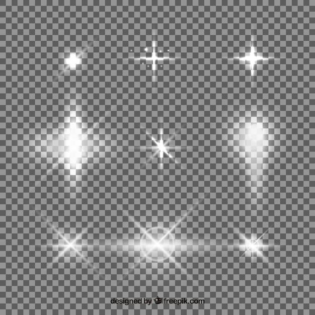 Set van witte lens flare met realistische stijl Gratis Vector