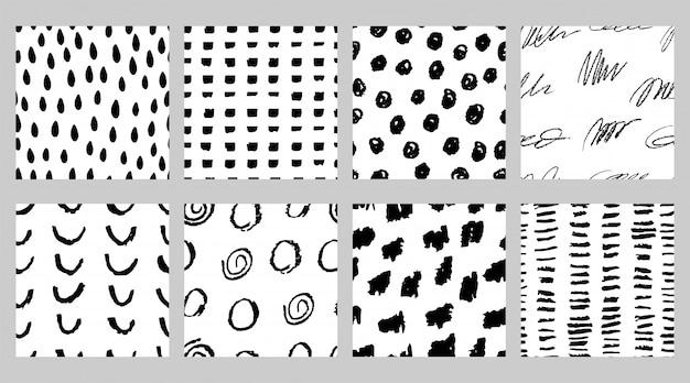 Set van zwart-wit naadloze patronen met stift en inkt in minimalistische scandinavische stijl Premium Vector