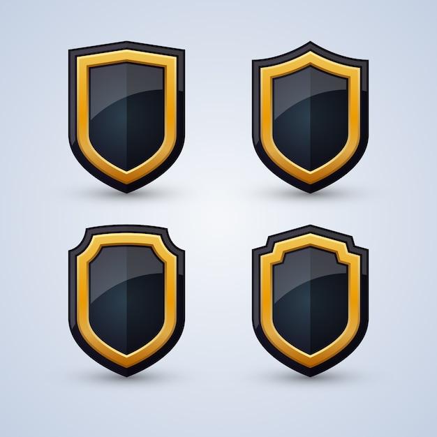 Set van zwarte en gouden schilden Premium Vector