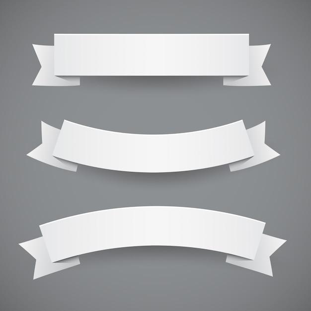 Set witboek golvende linten of vlaggen Premium Vector
