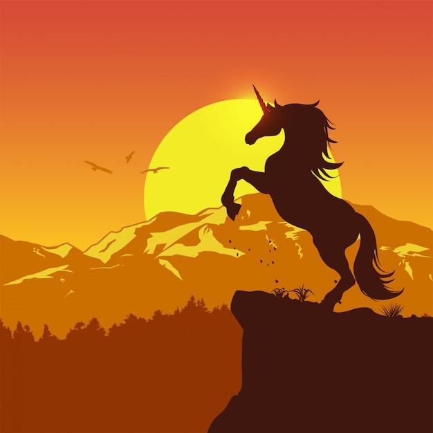 Silhouet van een schichtige eenhoorn bij zonsondergang, vectorillustratie Premium Vector