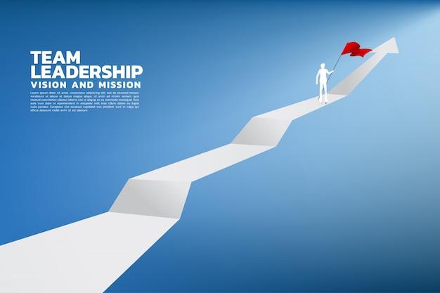 Silhouet van zakenman met de rode vlag die zich op de bovenkant van grafiek bevindt. Premium Vector