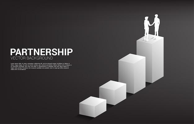 Silhouet van zakenmanhanddruk bij het kweken van grafiek. concept van teamwork partnerschap en samenwerking. Premium Vector