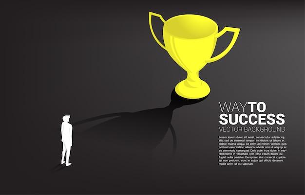 Silhouet zakenman doel om kampioen trofee. zakelijk leiderschap doel en visie missie Premium Vector