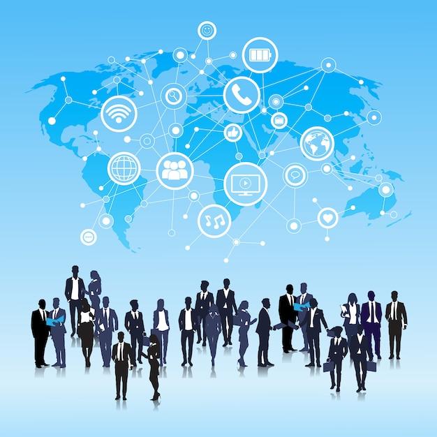 Silhouet zakenmensen groep social media pictogrammen over world map achtergrond netwerk Premium Vector