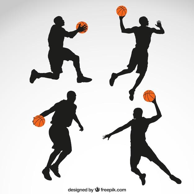 Silhouetten van de basketbalspeler Gratis Vector