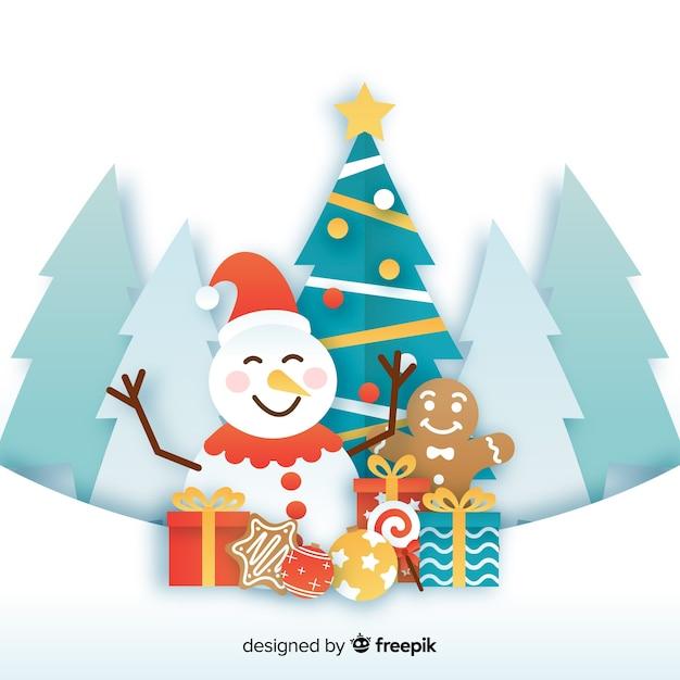 Sneeuwpop en presenteert seizoensgebonden papierstijl Gratis Vector
