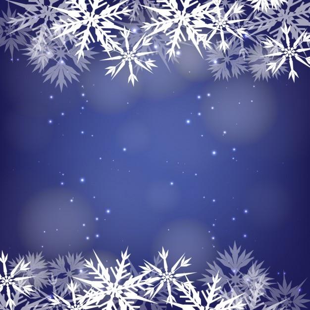 Sneeuwvlokken frame op een blauwe achtergrond bokeh Gratis Vector