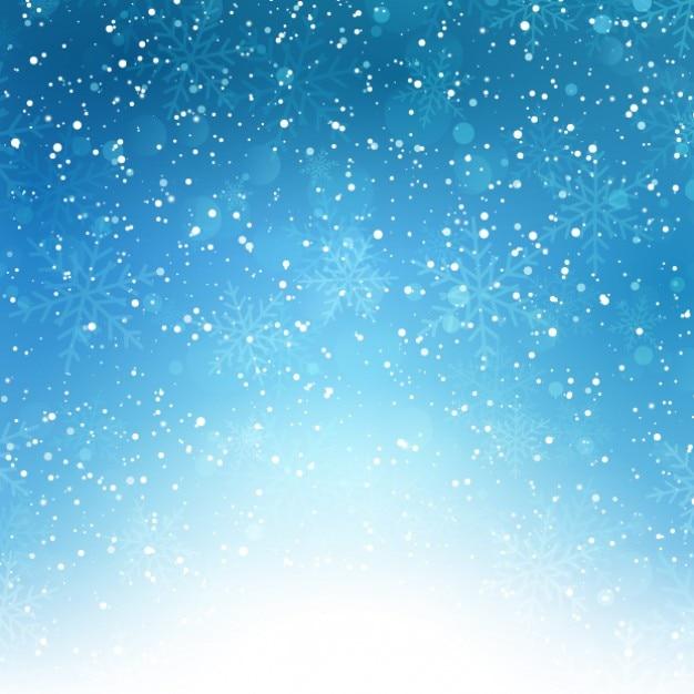 Sneeuwvlokken op een blauwe achtergrond bokeh Gratis Vector