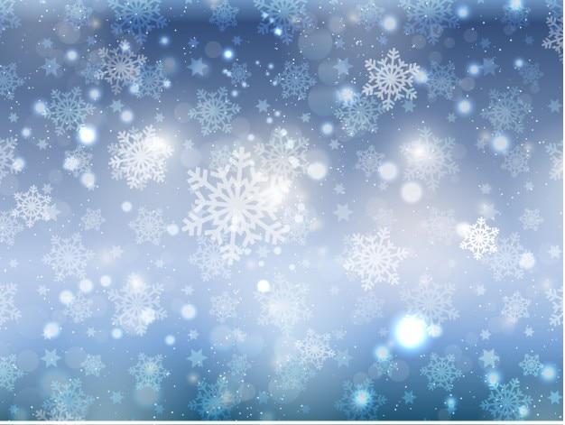 Sneeuwvlokken op een bokeh achtergrond Gratis Vector