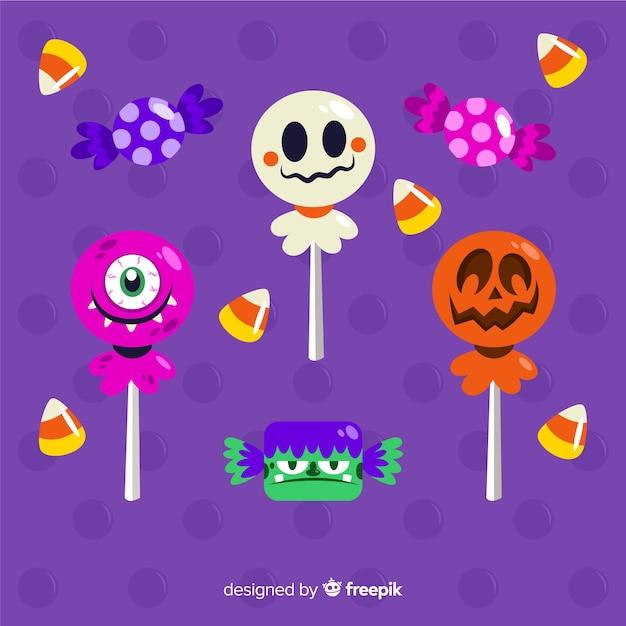 Snoepjes versierd met halloween elementen Gratis Vector