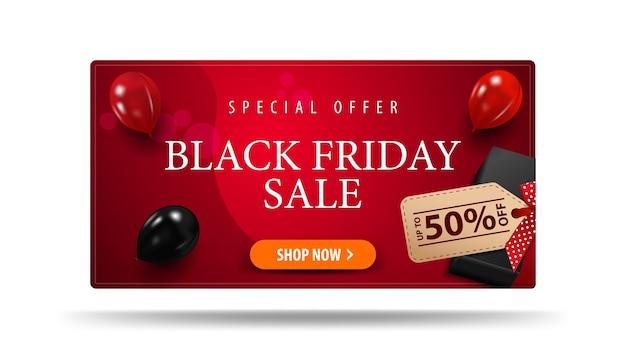 Speciale aanbieding, black friday-uitverkoop, tot 50% korting, rode kortingsbanner met zwart cadeau met prijskaartje met aanbieding en rode en zwarte ballonnen, bovenaanzicht. Premium Vector