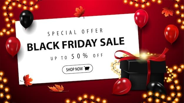 Speciale aanbieding, black friday-uitverkoop, tot 50% korting, rode kortingsbanner met zwart cadeau voor black friday, wit vel met aanbieding, knop en slingerframe Premium Vector