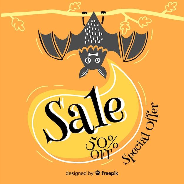 Speciale aanbieding hand getrokken halloween verkoop Gratis Vector