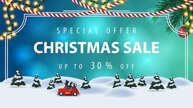 Speciale aanbieding, kerstuitverkoop, tot 30% korting, blauwe kortingsbanner met vintage frame, slingers, kerstboom en cartoon winterlandschap met rode vintage auto met kerstboom Premium Vector
