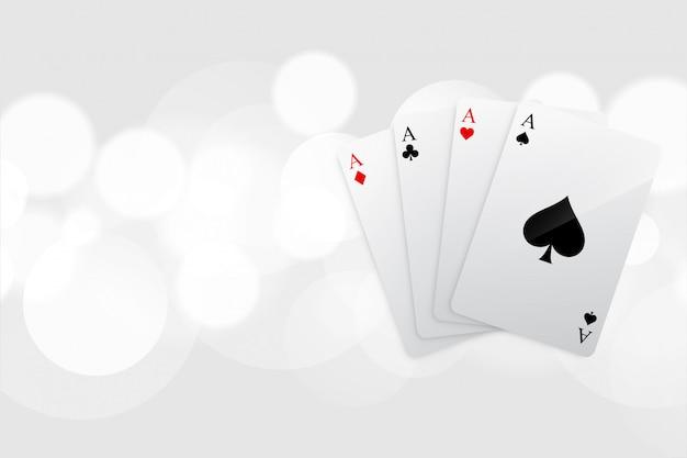 Speelkaarten aas witte bokeh achtergrond Gratis Vector