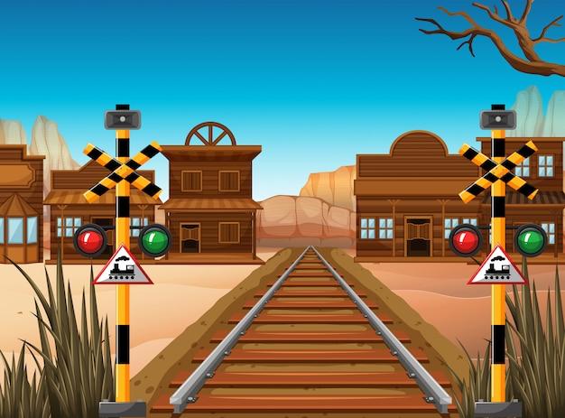 Spoorwegscène in de westelijke stad Premium Vector