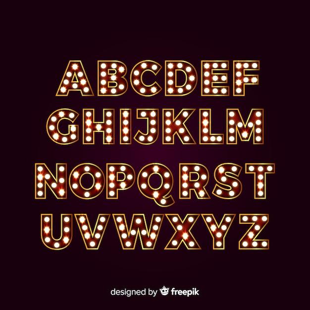 Spotlight-alfabet met theaterlichten Gratis Vector