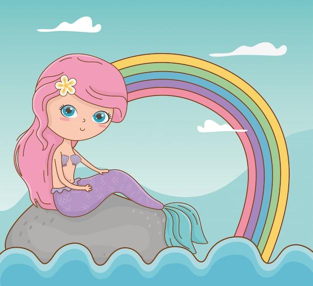 Sprookjesachtige zeegezichtscène met meermin en regenboog Gratis Vector