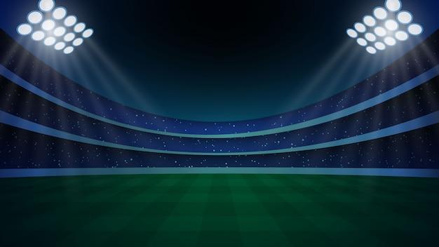 Stadion met verlichting, groen gras en nachthemel. Premium Vector