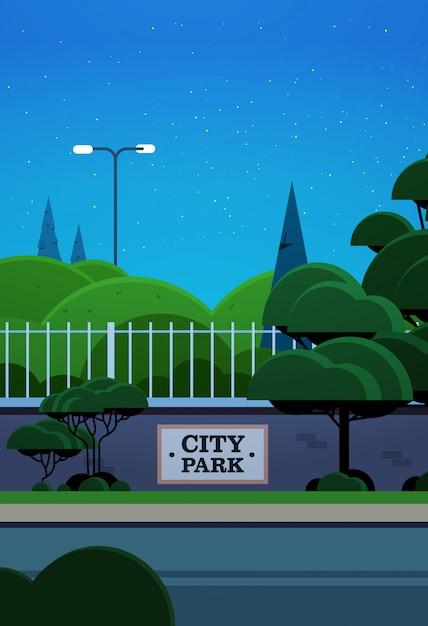 Stadspark banner op hek mooie nacht landschap achtergrond verticaal Premium Vector