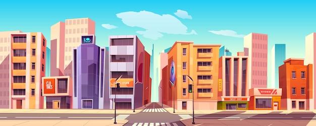 Stadsstraat met huizen, winkels en over de weg Gratis Vector