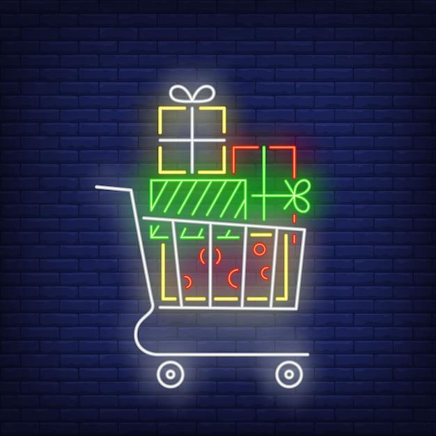 Stapel geschenken in winkelwagen in neon stijl Gratis Vector