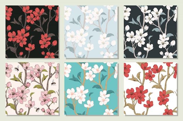 Stel de verzameling in met naadloze patronen. bloeiende boombloemen. lente bloemen textuur. hand getekend botanische vectorillustratie. kersenbloesem takken Premium Vector