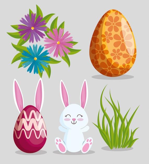 Stel pasen konijn met eieren decoratie en bloemen Gratis Vector