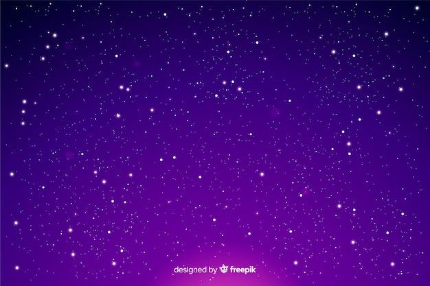 Sterren op een gradiënt nachtelijke hemel Gratis Vector