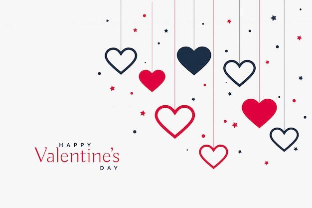 Stijlvolle hangende harten achtergrond voor Valentijnsdag Gratis Vector