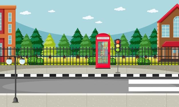 Straat side scene met rode telefooncel scene Gratis Vector
