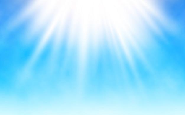 Stralende zon op blauwe hemel. Premium Vector