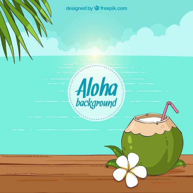 Strand achtergrond met kokosnoot en hand getekende bloem Gratis Vector